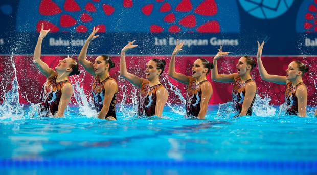 Splash down: Hands up who would rather be doing a bit of synchronised swimming than clearing out a shed of a Saturday