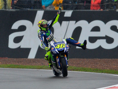 Doctor in the house: Valentino Rossi wins the British Grand Prix despite taking part in an ill-advised impromptu hokey-cokey
