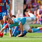 Dann buster: Scott Dann attempts to put the 'ooooooo' in Sergio Aguero with a goodold-fashioned challenge