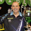 Power and the glory: Phil Taylor celebrates with the Champions League trophy, the darts one, or else he is much bigger than we originally thought