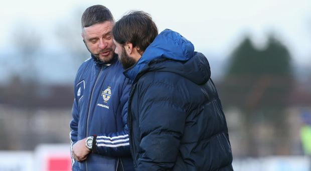 Gary Hamilton talks to fourth official Raymond Crangle at the Ballymena Showgrounds