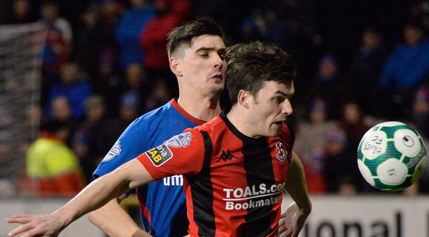 Close call: Linfield's Jimmy Callacher and Philip Lowry of Crusaders will be key men