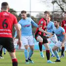That's handy: Ballymena United's Ryan Harpur gets too close to the ball in Saturday's clash with Crusaders