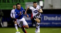 Playing catch-up: Linfield's Josh Robinson tries to close down Michael Duffy of Dundalk