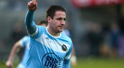 Going to Town: Alan O'Sullivan celebrates one of his two goals for Warrenpoint against Coleraine on Saturday