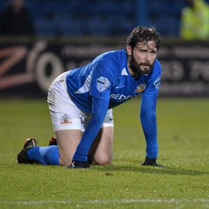 Kneesy does it: Gary Hamilton takes a well-deserved breather in last Friday's game with Linfield