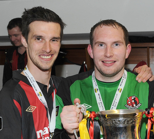 Declan Caddell and Sean O'Neill celebrate Crusaders' Setanta Cup victory over Derry City back in 2012