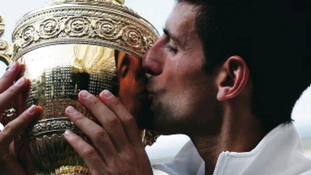 Prize guy: Novak Djokovic seals his Wimbledon title with a kiss