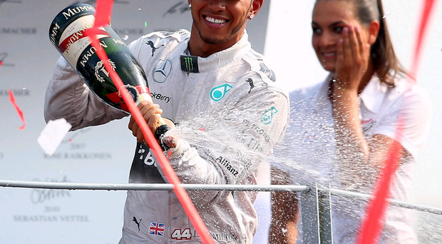 Cheers: Lewis Hamilton celebrates his win at Monza yesterday