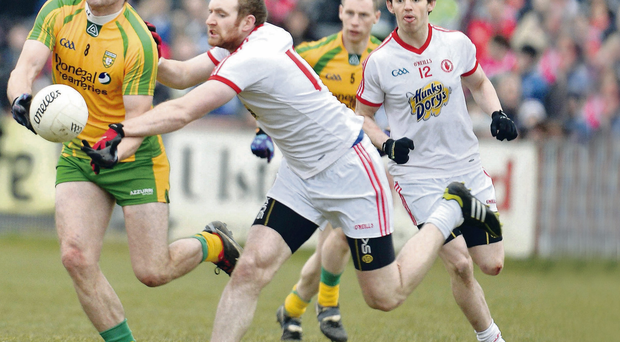 Tyrone's Aidan Cassidy and Donegal's Neil Gallagher