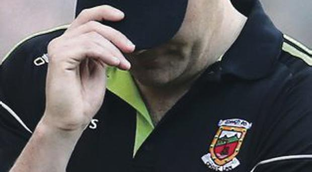 Head down: James Horan after Mayo's All-Ireland final defeat