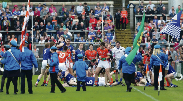 Shameful scenes: Sports fans all over the world watched as Armagh and Cavan players fought before Sunday's game