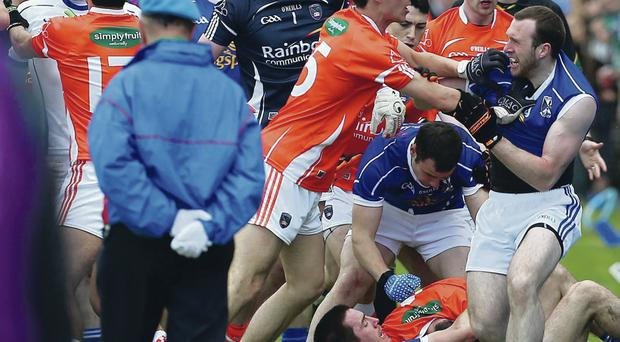 Ugly scenes: Armagh and Cavan stars brawl before their Ulster Championship clash at the Athletic Grounds