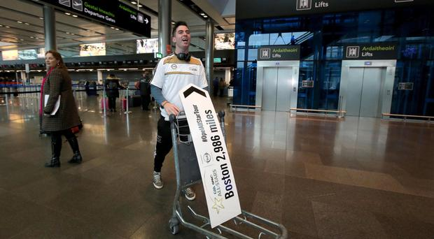 Come fly with me: Michael Darragh MacAuley leaves Dublin Airport bound for the All-Stars game in Boston