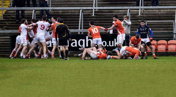 Ugly scenes: The McKenna Cup clash between Armagh and Tyrone require a clarification of certain rules to decrease such melees