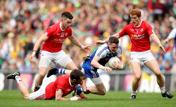 Triple team: Tyrone's Richie Donnelly, Ronan McNamee and Peter Harte tackle Conor McManus of Monaghan