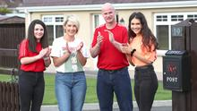 Round of applause: Ryan Farquhar with wife Karen and daughters Keeley and Mya