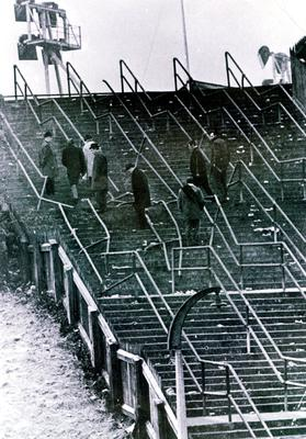Aftermath of horror: Safety experts examine the mangled barriers of Stairway 13 following the Ibrox Disaster of January 1971