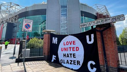 Mixed emotions: A banner outside Old Trafford sums up Manchester United supporters' feelings for the club's ownership. Credit: Simon Peach/PA