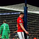 Oh dear: Phil Jones after scoring an own-goal against Spurs last January