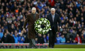 Lest we forget: the late Billy McNeill (left) and John Greig, respective club captains of Celtic and Rangers at the time of the Ibrox Disaster, carry a wreath onto the pitch to mark the 40th anniversary of the tragedy