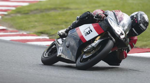 Riding high again: Andy Reid on way to Oulton Park victory