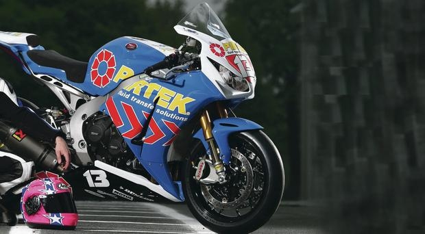 Welcome boost: Lee Johnston shows off Pirtek as his NW200 sponsor