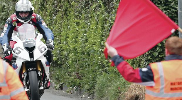 Seeing red: Michael Dunlop's progress is halted by a red flag at last night's Isle of Man TT practice