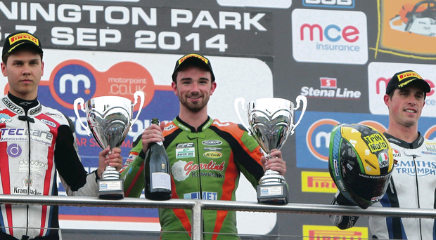 Winner: Glenn Irwin (centre) on the podium with Luke Mossey and Graeme Gowland double red