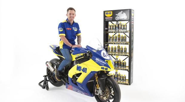 All smiles: Jack Kennedy poses on his new WD-40 Kawasaki after opting to return to Superbikes after a two-year absence