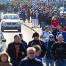 Cut short: Crowds at the NW200 head home early after the event was ended early
