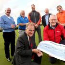 Cheque mates: Captain of Royal Portrush Golf Club Michael Taylor presents a cheque for £10,000 to Ian Crowe, Chairman of the Air Ambulance NI, as Liam Beckett, Albert Kirk, Stephen Ferris, Mervyn Whyte and Adrian Logan look on