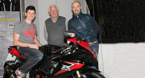 Full speed ahead: Millsport Racing's new signing Dan Kneen with team owners James and Patrick Murray