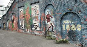 Lick of paint: The wall featuring Northern Ireland football icons is in desperate need of a facelift