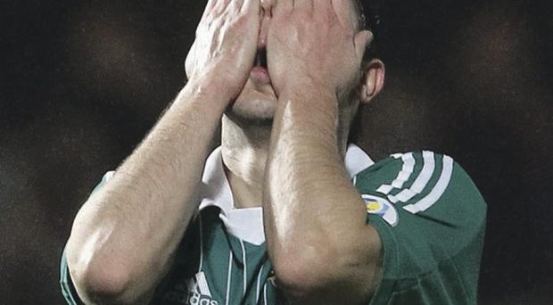 Gareth McAuley shows his frustration against Luxembourg