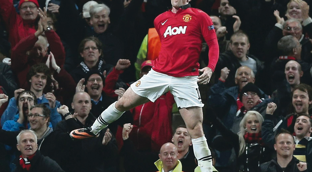 Jumping for joy: Wayne Rooney celebrates scoring and the Manchester United fans enjoy the moment