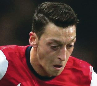 Class act: Mesut Ozil has inspired Arsenal