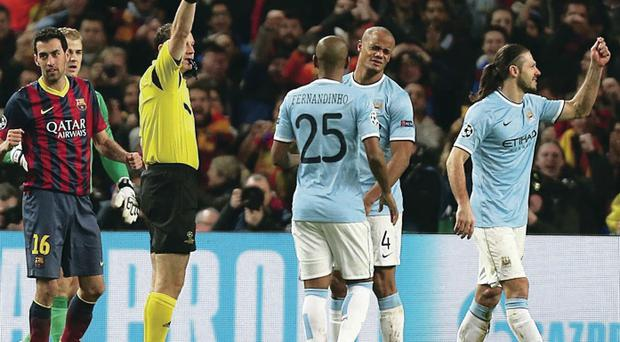 Off you go: Martin Demichelis is shown the red card last night