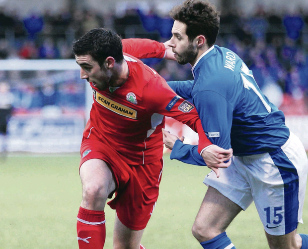 Clash of titans: Joe Gormley of Cliftonville and Linfield's Sean Ward