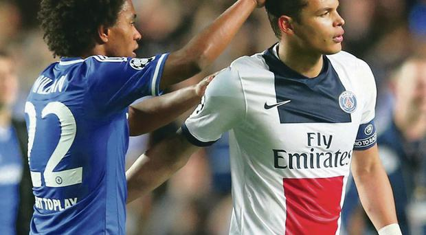 Willian (left) consoles fellow Brazilian and PSG captain Thiago Silva after the full-time whistle at Stamford Bridge