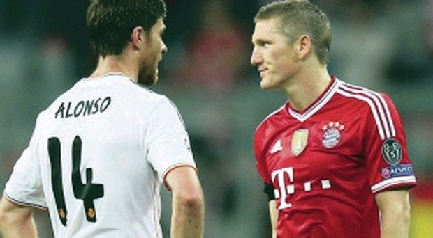 Xabi Alonso was booked in Munich for a challenge on Bayern's Bastian Schweinsteiger