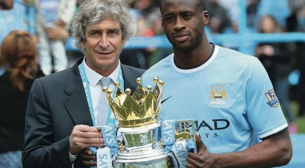 Blues' boss Manuel Pellegrini with Yaya Toure