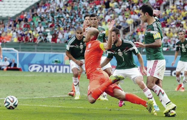 Pivotal moment: Dutch star Arjen Robben is sent tumbling by Rafael Marquez of Mexico for the match-deciding penalty yesterday