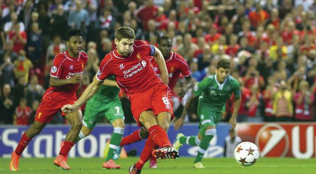 Cool as you like: Steven Gerrard scores the injury time penalty that gave Liverpool victory