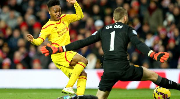 No way through: David de Gea stands tall to block a shot from Liverpool starlet Raheem Sterling at Old Trafford