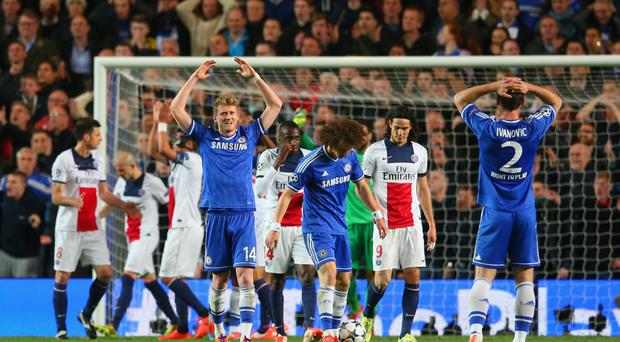 Squeezed through: Chelsea celebrate last year's PSG victory