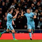 City surge: Manchester City's Sergio Aguero (right) celebrates his goal against Barcelona with James Milner