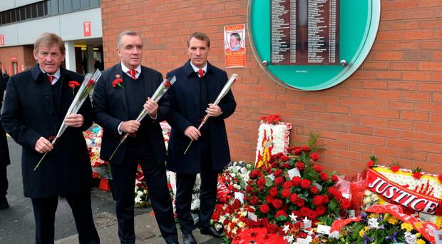 Reds remember Former Liverpool player and manager Kenny Dalglish (L), Chief Executive Ian Ayre (C) and current manager Brendan Rodgers lay flowers a the temporary Hillsborough memorial at Anfield