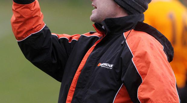 Class act: Michael Hughes celebrated Carrick Rangers winning promotion to the top flight