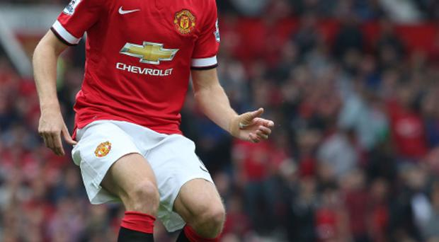 Moving on: Jonny Evans has a big decision to make